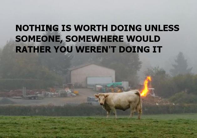 Far away cow doing it